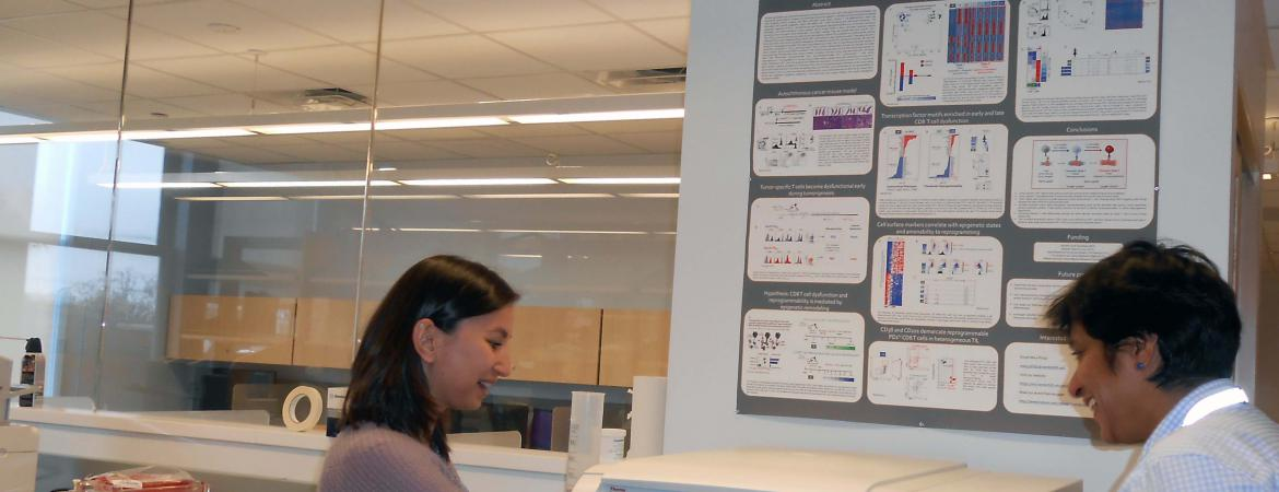 Dr. Phililp and Ms. Anzarova at the ultra centrifuge preparing samples- cropped